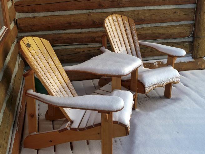 Snow-Covered Adirondack Chairs
